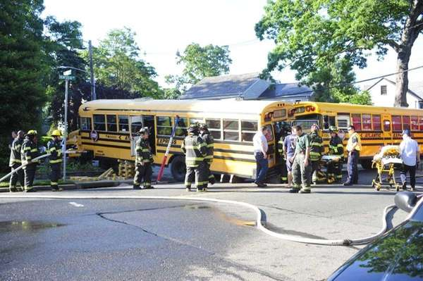 Two school buses, one of them carrying Chaminade