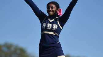 The Bayport-Blue Point varsity cheerleaders entertain spectators during