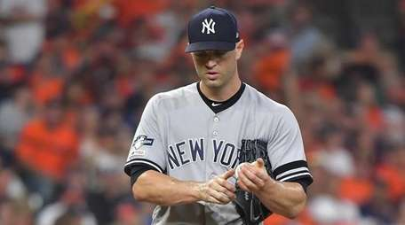 Yankees starting pitcher J.A. Happ reacts in the