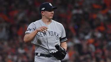 Yankees relief pitcher Chad Green (57) reacts to