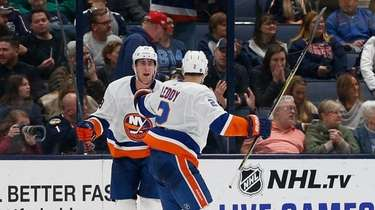 Islanders' Brock Nelson, left, celebrates his game-winning goal