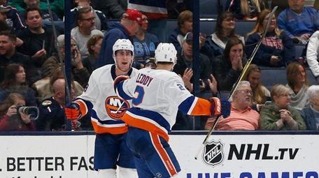 Islanders' Brock Nelson, left, celebrates his game-winning goal