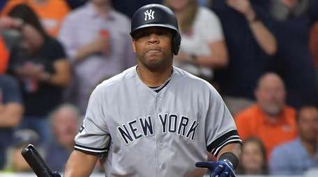 Yankees designated hitter Edwin Encarnacion reacts after striking
