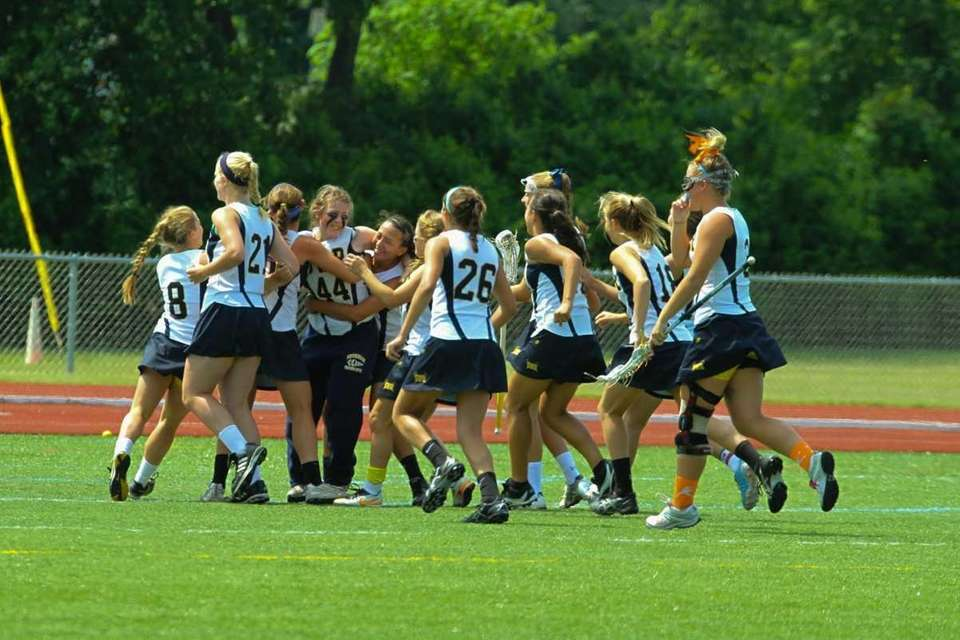 Shoreham Wading's girls lacrosse team celebrates their semifinal