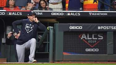 Yankees manager Aaron Boone does some nailbiting during
