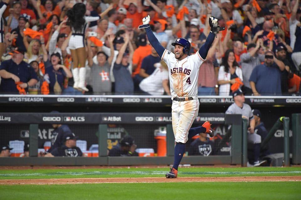 Houston Astros center fielder George Springer (4) celebrates