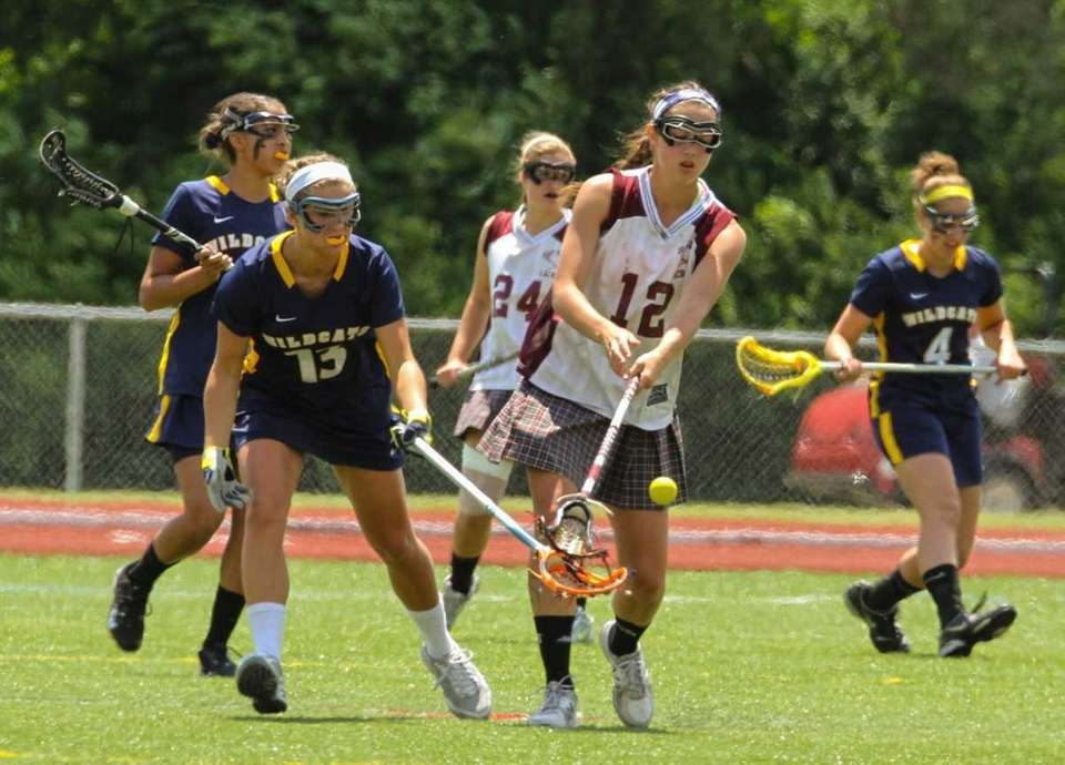 Bay Shore's #12 Caroline De Lyra knocks a