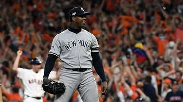 Yankees relief pitcher Aroldis Chapman (54) watches after
