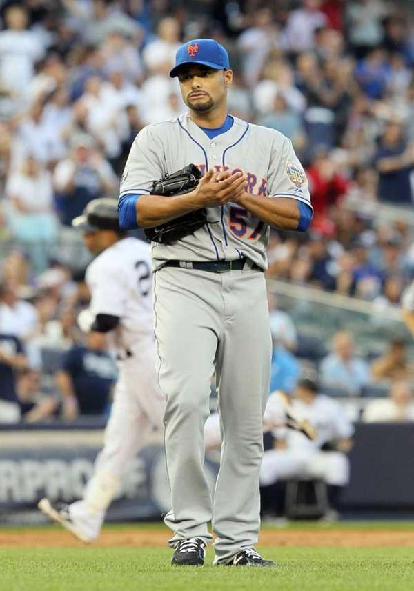 Johan Santana looks on after surrendering a second
