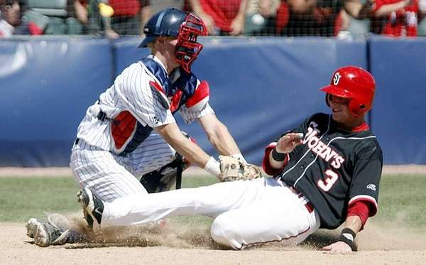 Arizona's Riley Moore tags out St. John's Sean