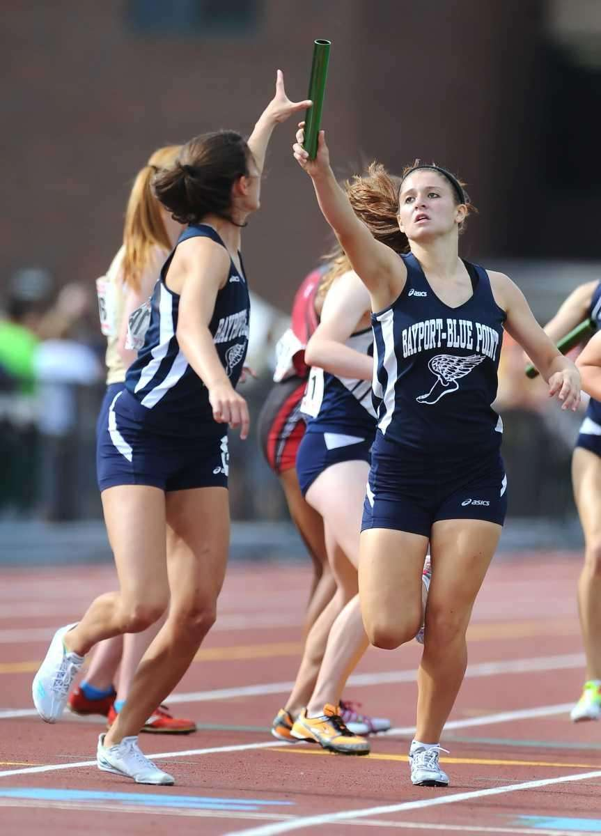 Bayport-Blue Point's Casey Hasher, right, passes the baton