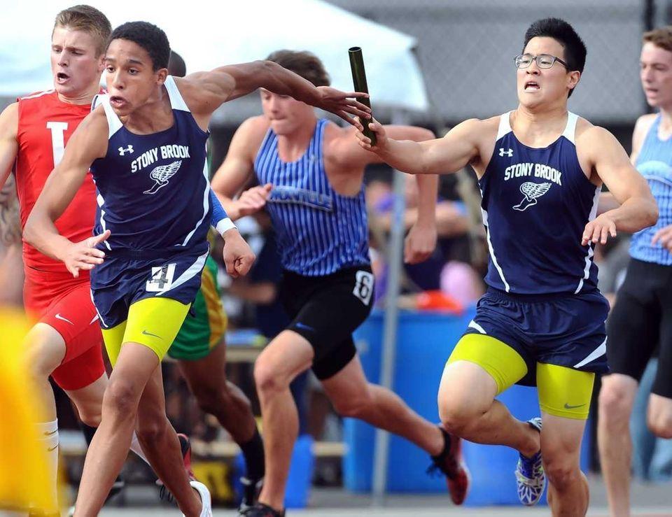 Stony Brook's Ed Kim, right, passes the baton