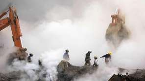 In this file photo, firefighters make their way