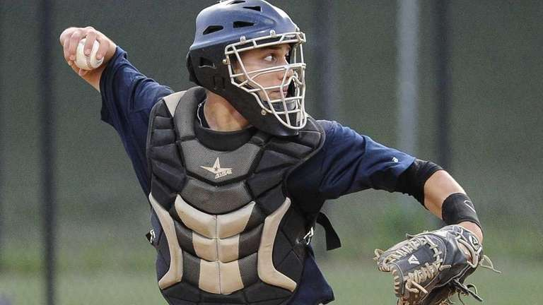 Suffolk catcher Charles Galiano (Commack) throws the ball