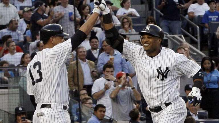 Robinson Cano, right, celebrates with Alex Rodriguez (13)