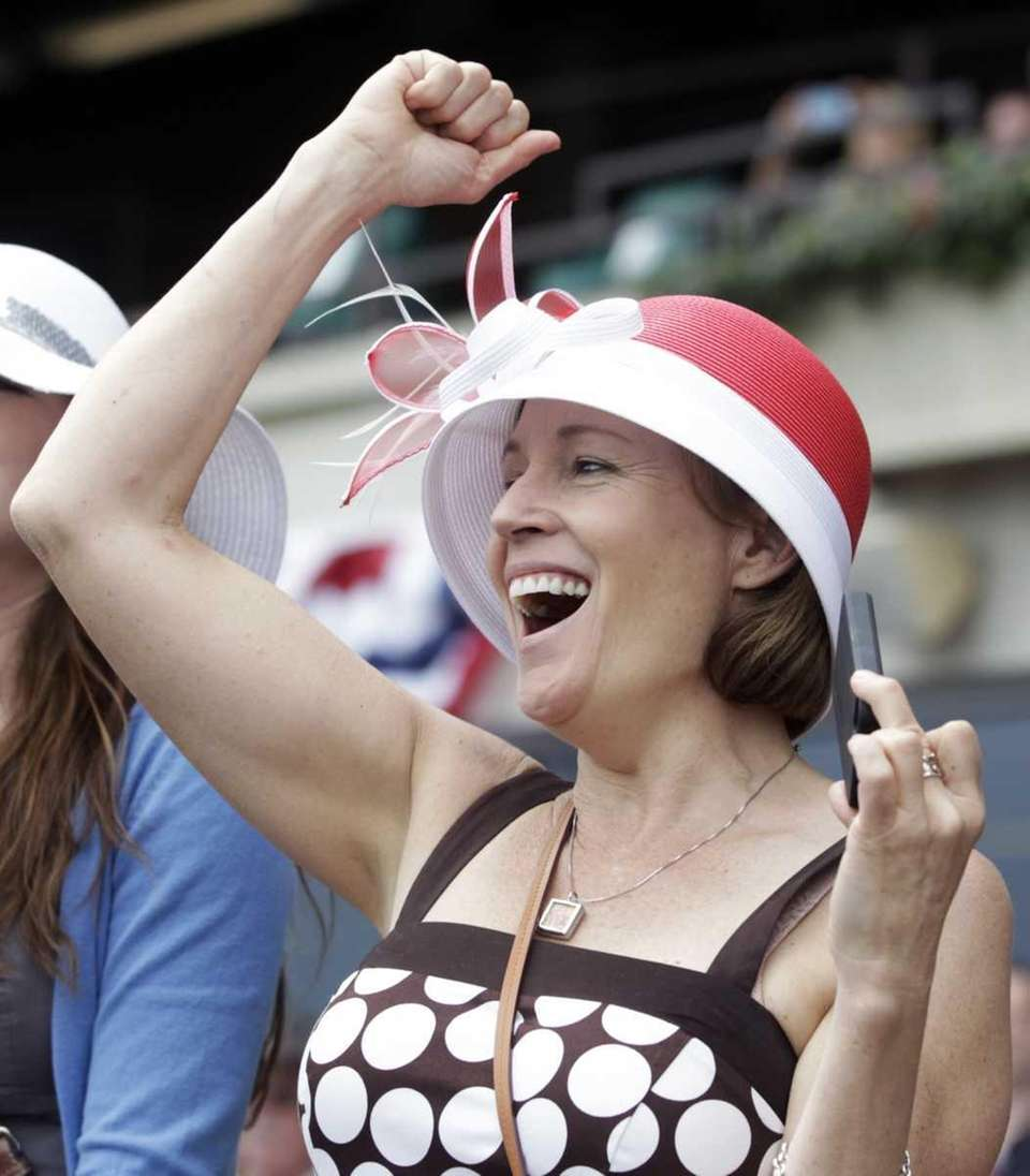 Diane Webster of Prospect, Conn., cheers on her