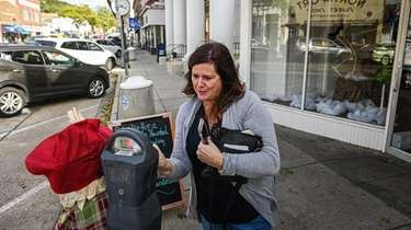 Eileen Schoenhut, of Lynbrook, feeds a meter in