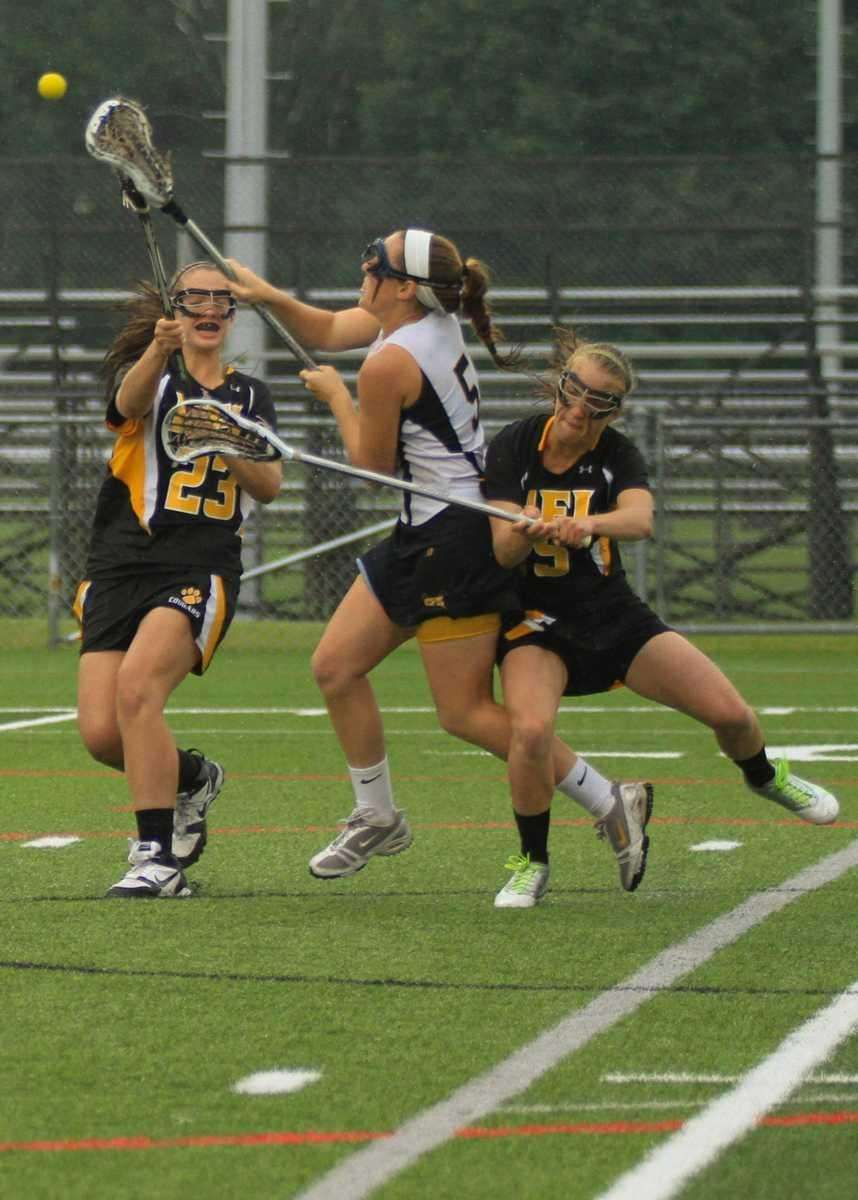 Shoreham Wading River's #5 Jessica Angerman shoots and