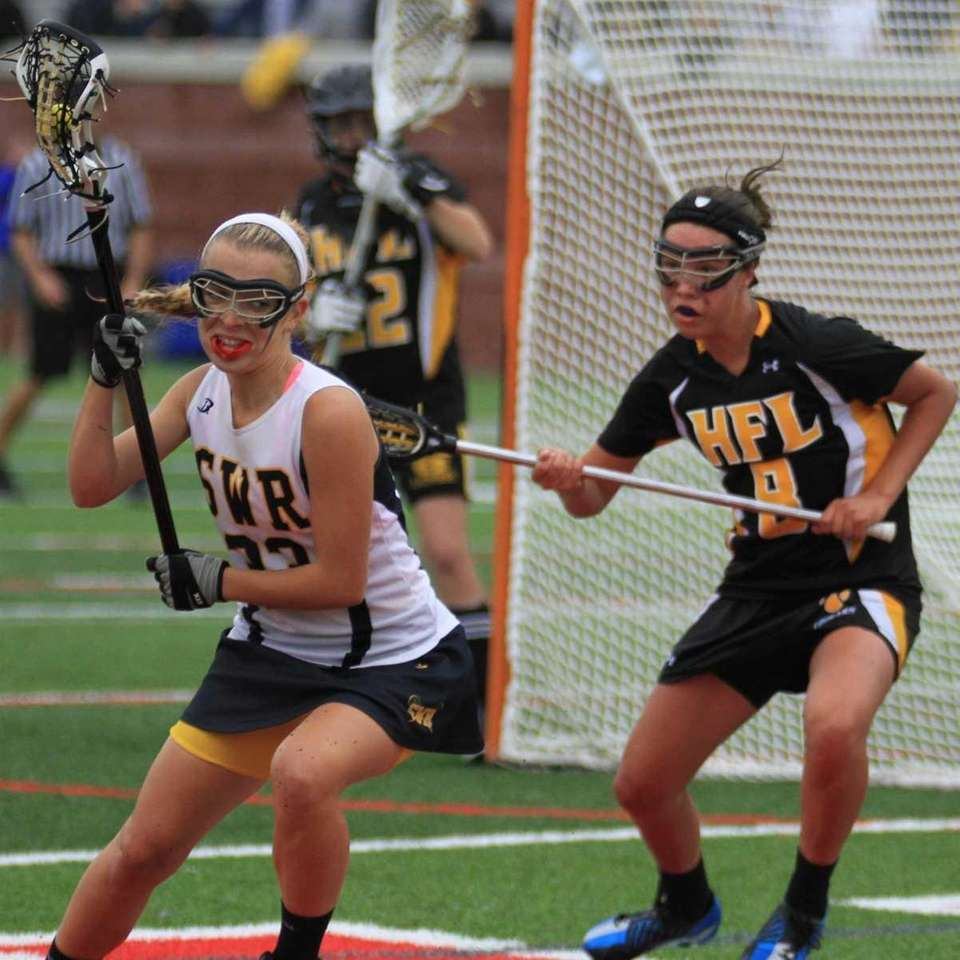 Shoreham Wading River's #33 Lauren Lustgarten protects the