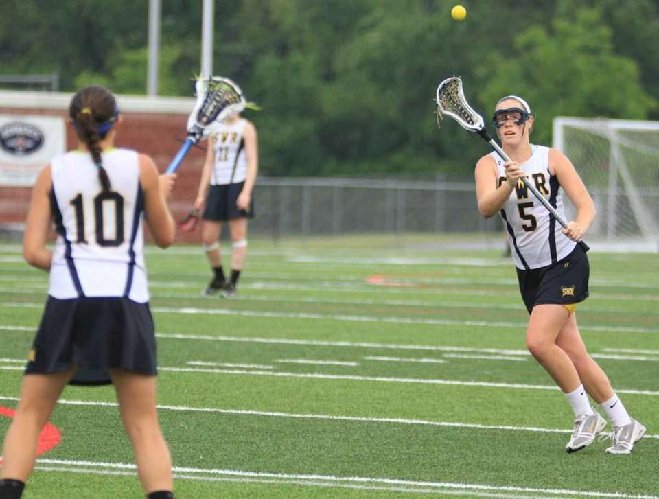 Shoreham Wading River's #10 Shannon Rosati passes to