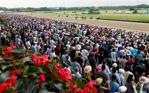 Spectators watch the third race at Belmont Park