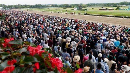 Spectators watch the third race at Belmont Park