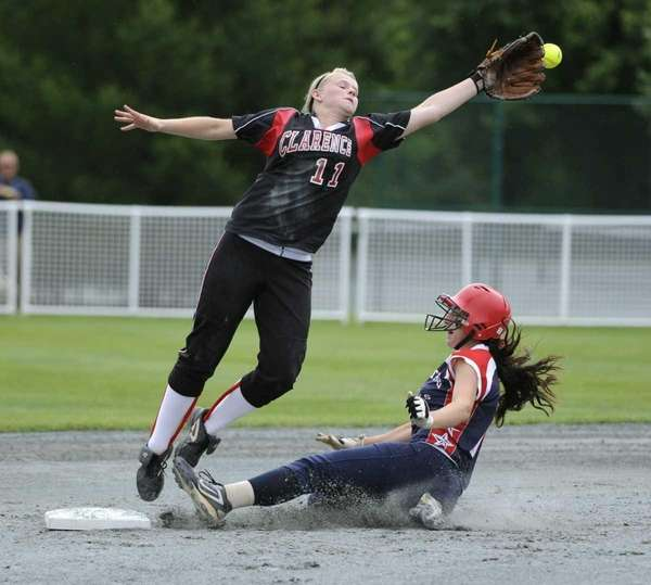 MacArthur's Jena Cozza, right, slides safely into second