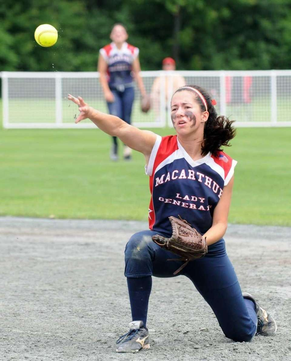 MacArthur's Krissy Gay fields a ball against Clarence