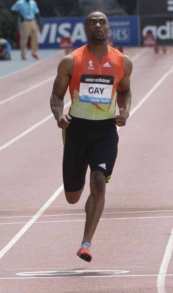 Tyson Gay crosses the finish line ahead of