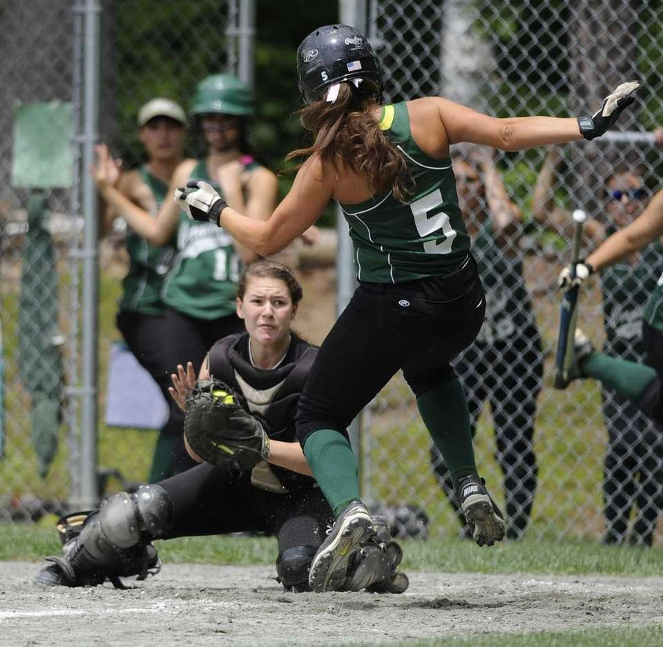 Sayville catcher Olivia Kaczmarek, left, puts out Cornwall's
