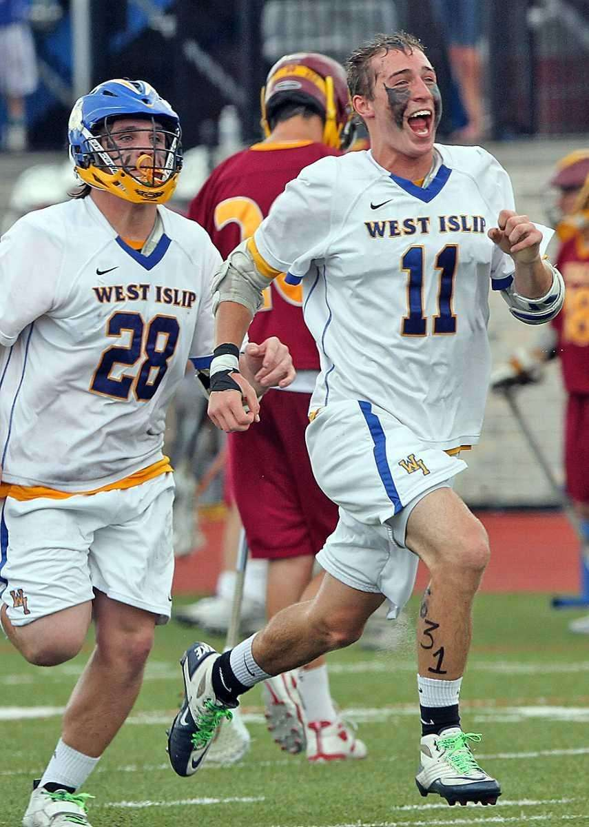 West Islip's Nick Aponte (right) races across the