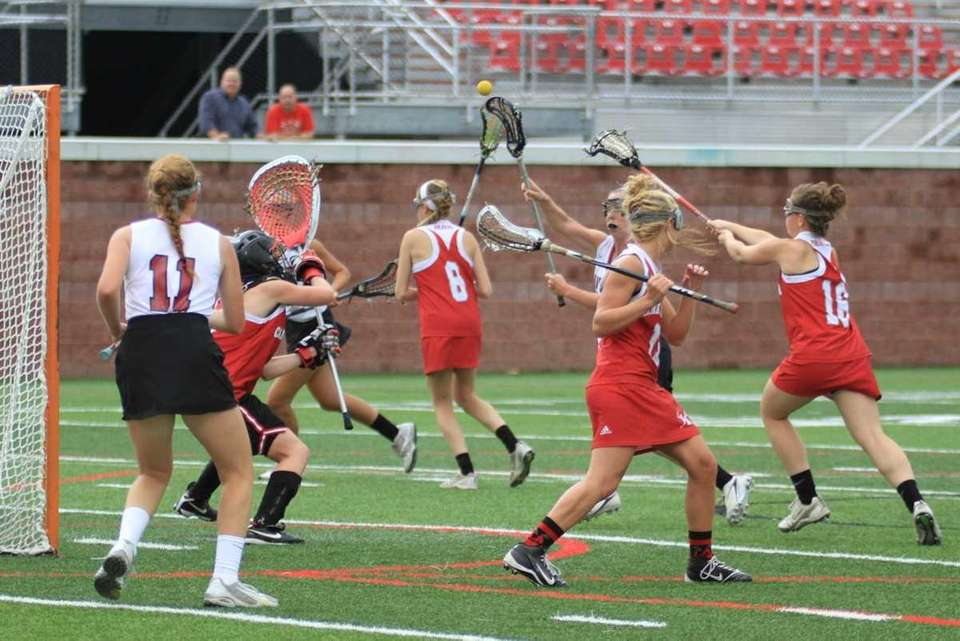 Garden City's #13 Catherine Dickinson shoots and scores