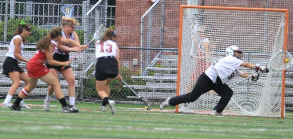 Garden City's goalie #98 Megan McDonald makes a