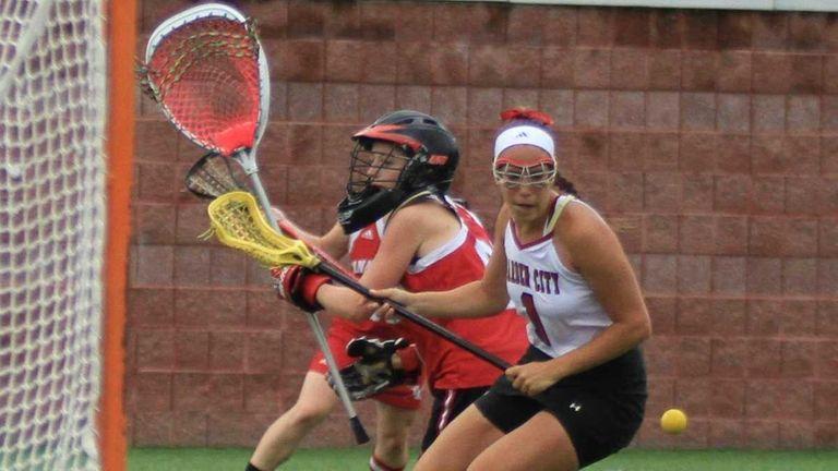 Garden City's #1 Alexandra Bruno knocks the ball