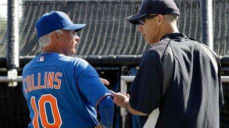 Mets manager Terry Collins, left, chats with Yankees