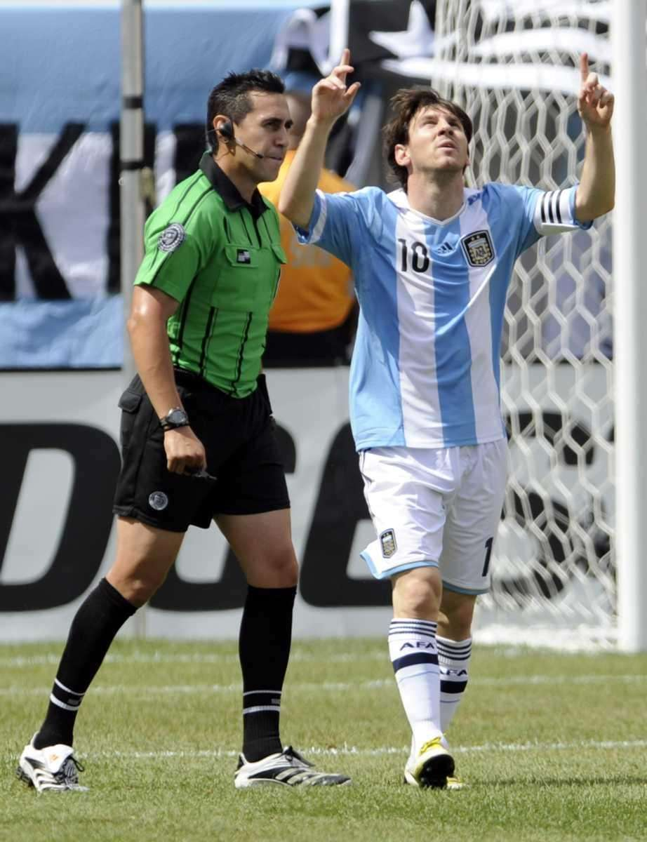 Argentina's Lionel Messi celebrates his goal as referee
