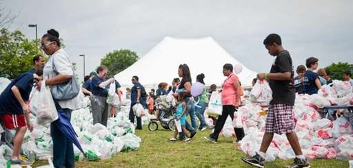 Long Island families pick up bags of donated