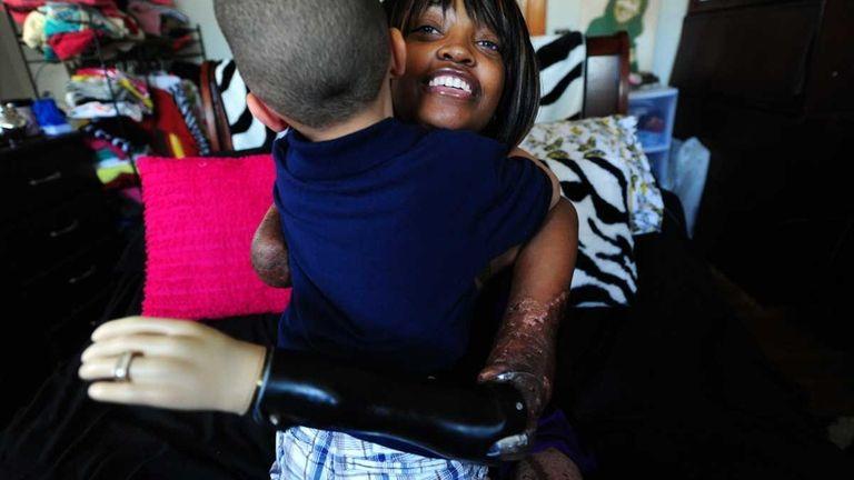 Shannon Smith hugs son Oliver. (June 7, 2012)