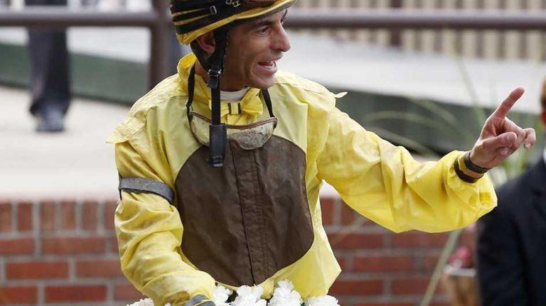 Jockey John Velazquez smiles aboard Union Rags after