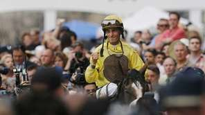 Jockey John Velasquez pumps his fist as he
