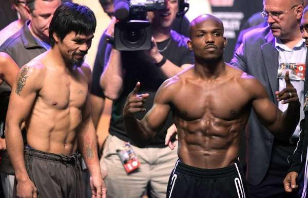Boxers Manny Pacquiao (L) of the Philippines, and