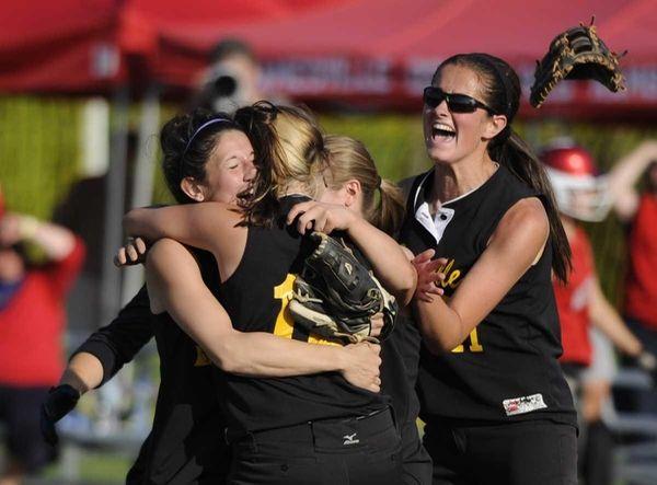 Sayville players celebrate their win over Jamesville-DeWitt in