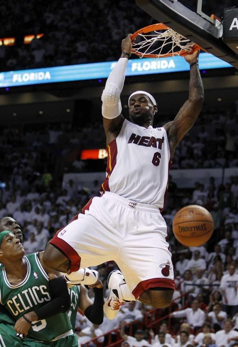 Miami Heat's LeBron James dunks over Boston Celtics'