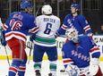 Rangers goaltender Henrik Lundqvist watches a video replay