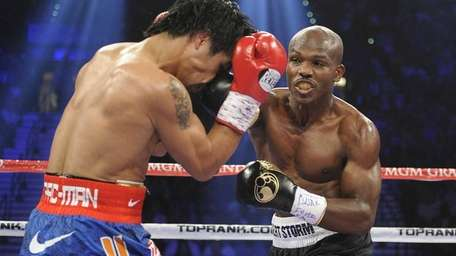 Manny Pacquiao, from the Philippines, left, covers up