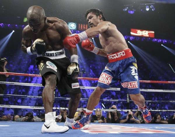Manny Pacquiao, right, connects with a punch against