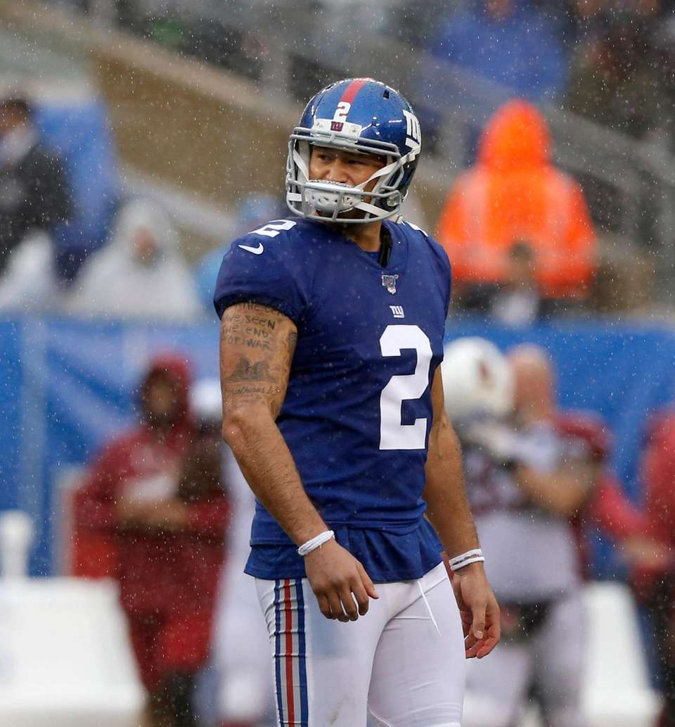 Aldrick Rosas of the Giants looks on after