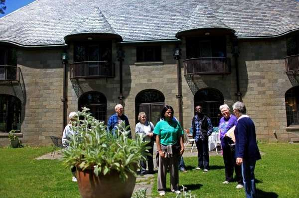 A crowd tours Scully Mansion at the Suffolk