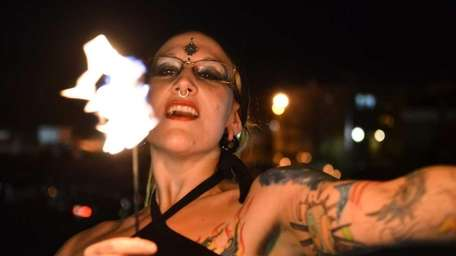 Lisa Elkins, of Movement Mosaic, dances with fire