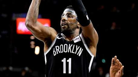 Kyrie Irving of the Nets attempts a jump